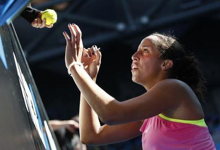 Keys of the U.S. signs autographs after defeating compatriate Brengle in their women's singles match at the Australian Open 2015 tennis tournament in Melbourne