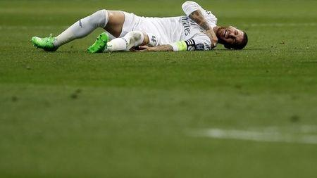 Real Madrid's Ramos grimaces in pain during their Champions League Group A soccer match against Shakhtar Donetsk at Santiago Bernabeu stadium in Madrid