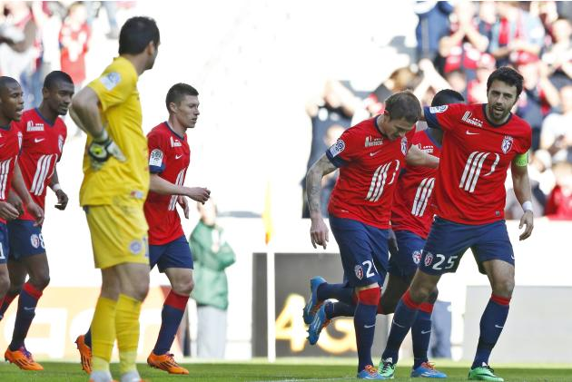 Lille's Roux celebrates with teammate Basa his goal against Montpellier during their French Ligue 1 match in Villeneuve d'Ascq