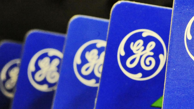 FILE - This file photo made April 11, 2008, shows General Electric Co. logo on products in Danvers, Mass. General Electric is reporting lower net income Thursday April 17, 2014 than a year ago because last year's results included the sale of NBC Universal. (AP Photo/Lisa Poole, File)