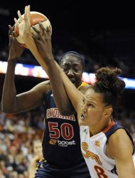 Indiana Fever's Jessica Davenport (50) tangles with Connecticut Sun's Mistie Mims in the second half of a WNBA basketball game in Uncasville, Conn., Wednesday, Sept. 19, 2012. Connecticut won 73-67. (AP Photo/Jessica Hill)