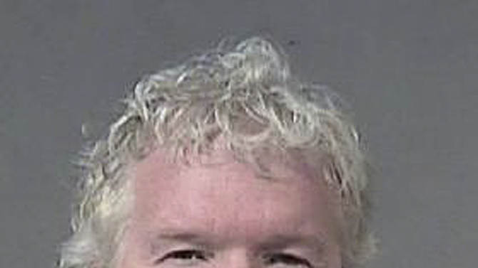 In this undated photograph provided by the Maricopa County Sheriff's Office, Michael Gilliland, the founder of Sunflower Farmers Market, is shown.  Gilliland was sentenced Tuesday, Jan. 8, 2013, to four weeks in jail for his guilty plea to misdemeanor attempted pandering.  Authorities say Gilliland agreed to pay $100 for sex in February 2011 in a police sting in which an undercover officer posed as a 17-year-old prostitute. Prosecutors say Gilliland showed up at a Phoenix hotel to meet the undercover even though she told the businessman during an earlier phone conversation that she was 17.  (AP Photo/Maricopa County Sheriff's Office)