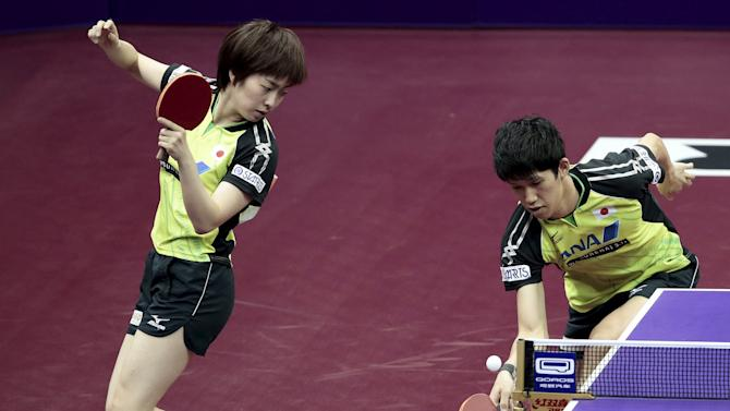 Japan's Yoshimura and Ishikawa play against Slovenia's Zibrat and Galic in their mixed doubles first round match at the World Table Tennis Championships in Suzhou