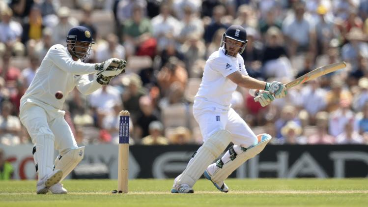 England's Bell hits out, watched by India's Dhoni, during the third cricket test match at the Rose Bowl cricket ground, Southampton, England July 28, 2014.