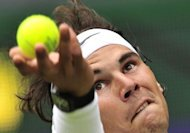 Spain&#39;s Rafael Nadal serves during his first round men&#39;s singles match against Brazil&#39;s Thomaz Bellucci on the second day of the 2012 Wimbledon Championships tennis tournament at the All England Tennis Club in Wimbledon. Nadal has criticised the decision to play the Olympic tennis tournament over the best of three sets rather than the five sets employed at Wimbledon and other Grand Slams