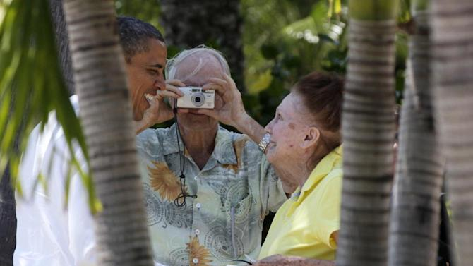President Barack Obama greets residents as he arrives for a campaign event, Tuesday, April 10, 2012, in Palm Beach Gardens, Fla. (AP Photo/Carolyn Kaster)
