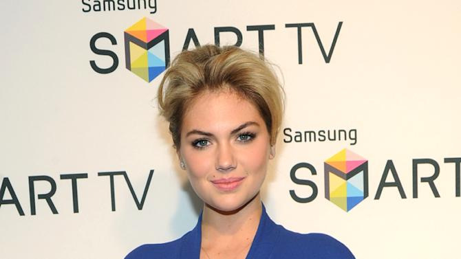 Model Kate Upton helps Samsung showcase its 2013 line of Smart TVs, Wednesday, March 20, 2013, in New York. Samsung's new line allows the viewer to discover more of the TV they love with a smarter and more personalized experience.  (Photo by Diane Bondareff/Invision for Samsung/AP Images)