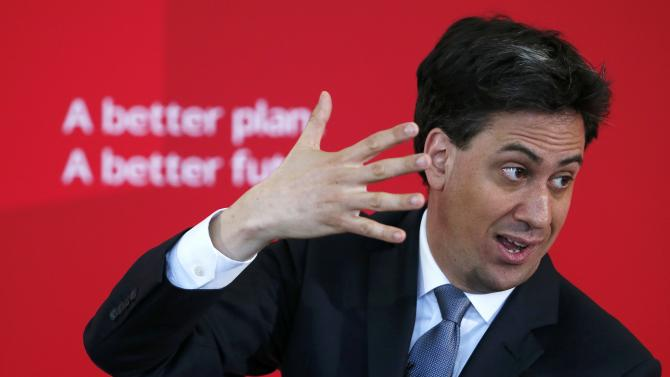 Britain's Labour Party leader Ed Miliband gestures during a speech on immigration at a campaign event in Pensby northern England