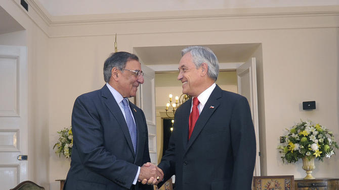 In this photo released by La Moneda Press Office, Chile's President Sebastian Pinera, right, shakes hands with U.S. Defense Secretary Leon Panetta at La Moneda presidential palace in Santiago, Chile, Thursday, April 26, 2012.  Panetta is on a two-day visit to Chile. (AP Photo/La Moneda Press Office,Jose Manuel de la Maza)