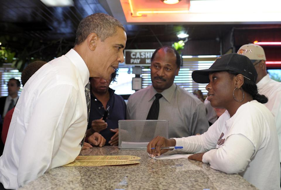 President Barack Obama orders a snack on a stop at Roscoe's House of Chicken and Waffles in Los Angeles, Monday, Oct. 24, 2011. Obama is on a three-day trip to the West Coast. (AP Photo/Susan Walsh)