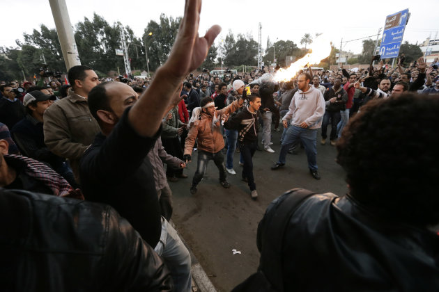 Egyptian President Mohammed Morsi's supporters and opponents clash outside the presidential palace, in Cairo, Egypt, Wednesday, Dec. 5, 2012. Wednesday's clashes began when thousands of Islamist suppo