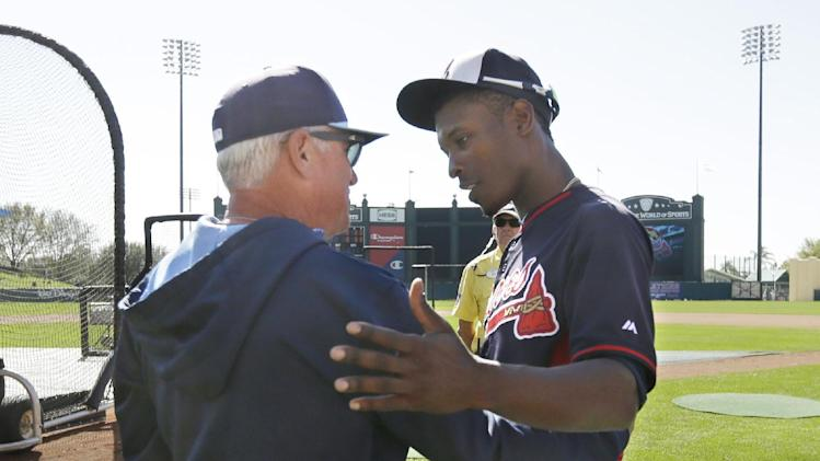 CORRECTS FIRST NAME TO B.J. NOT JUSTIN - Tampa Bay Rays manager Joe Maddon, left, greets Atlanta Braves left fielder B.J. Upton during batting practice before a spring exhibition baseball game in Kissimmee, Fla., Friday, March 14, 2014