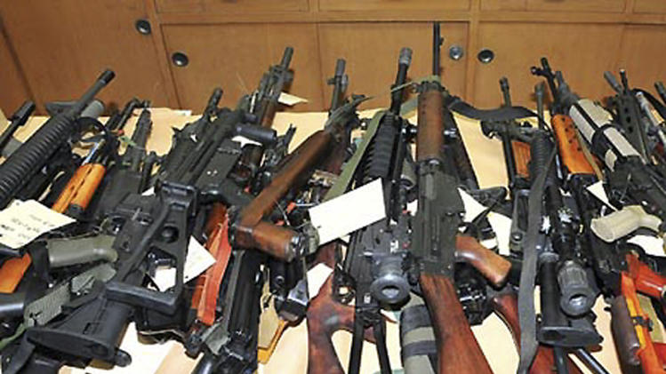 This image released by the Fresno County Sheriff via KMPH-TV shows guns seized from Christopher Haga, who was arrested is Sept. 2011 after police found this stash of assault rifles. Haga reportedly offered legal help from the National Rifle Association. The NRA has taken on California and other states over their strict requirements on who can carry concealed weapons and cities like San Francisco over their bans of high-capacity magazines. Their multi-million legal campaign has had mixed success so far, but the NRA appeals its losses, publicizes its wins and decides where to fight next. (AP Photo/Fresno County Sheriff via KMPH-TV)