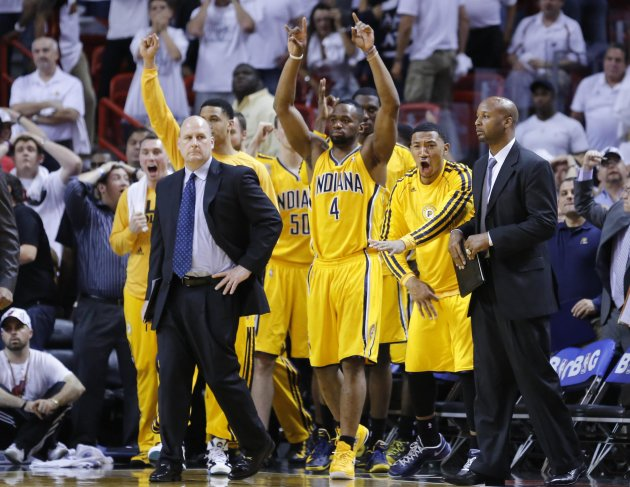 Indiana Pacers' Sam Young and teammates celebrate after Paul George made a game-tying three point shot to end regulation time during Game 1 of their NBA Eastern Conference final basketball playoff aga