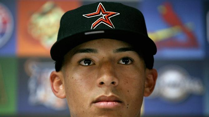 Student and baseball player Carlos Correa attends a press conference in Caguas, Puerto Rico, Tuesday, June 5, 2012. Correa, the 17-year-old slugging shortstop made hometown history on Monday after being selected by the Houston Astros as No. 1 in the Major League Baseball draft, becoming the first No. 1 overall pick from Puerto Rico. (AP Photo/Ricardo Arduengo)