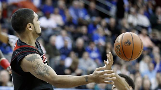 Louisville guard Peyton Siva, left, loses the ball against Seton Hall guard Tom Maayan during the first half of an NCAA college basketball game on Wednesday, Jan. 9, 2013, in Newark, N.J. (AP Photo/Julio Cortez)