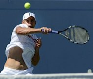 Andy Roddick of the US hits the ball against Rhyne Williams of the US during their men&#39;s first round 2012 US Open match at the USTA Billie Jean King National Tennis Center in New York. Rodick won 6-3, 6-4, 6-4