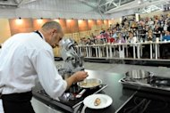 Spanish chef Oriol Rovira holds a cooking lesson at the Taste Fair (Salone del gusto) on October 22 in Turin. In a world dogged by conflicts and wars, the key to peace and reconciliation lies in food, say chefs, small-scale producers and Slow Food campaigners at the world's biggest food fair in Turin