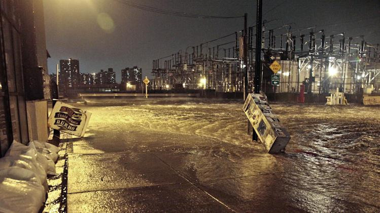 Streets around a Con Edison substation are flooded as the East River overflows into the Dumbo section of Brooklyn, N.Y., as Sandy moves through the area on Monday, Oct. 29, 2012. After a gigantic wall of water defied elaborate planning and swamped underground electrical equipment at a Consolidated Edison substation in Manhattan's East Village, about 250,000 lower Manhattan customers were left without power. (AP Photo/Bebeto Matthews)