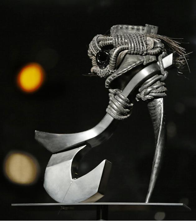 "This Feb. 11, 2013 photo shows Masaya Kushino's ""Storm Horse"" shoe, which features strands of a horse's mane, is displayed at the ""Shoe Obsession"" exhibit at The Museum at the Fashion Institute of Tec"