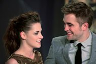"US actress Kristen Stewart (L) and British actor Robert Pattinson pose prior to the German premier of ""The Twilight Saga: Breaking Dawn - Part 2"" film premier in Berlin on November 16, 2012. The last installment of the blockbuster ""Twilight"" franchise has won the dubious honor of being nominated in every category for Hollywood's anti-Oscar Razzie awards"
