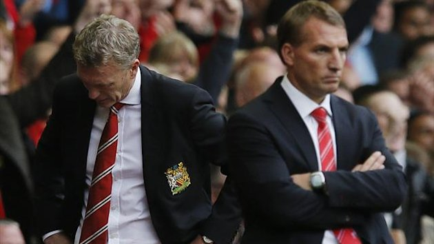 Manchester United's manager David Moyes (L) reacts as Liverpool's manager Brendan Rodgers watches (Reuters)