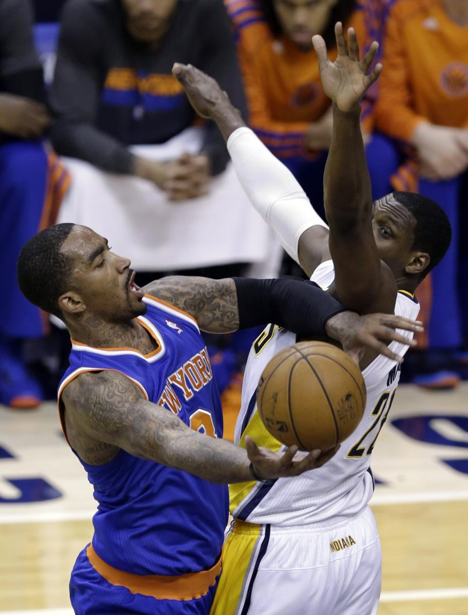 New York Knicks guard J.R. Smith, left, attempts a shot against Indiana Pacers center Ian Mahinmi during the first half of Game 4 of the Eastern Conference semifinal NBA basketball playoff series, in Indianapolis on Tuesday, May 14, 2013. Smith was called for an offensive foul. (AP Photo/Michael Conroy)