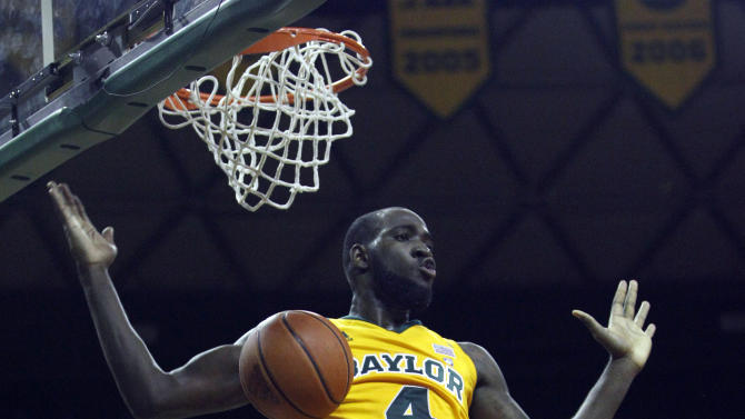 Baylor's Quincy Acy (4) reacts after a slam dunk in front of San Diego State's Deshawn Stephens (23) during the first half of an NCAA college basketball game, Tuesday, Nov. 15, 2011, in Waco, Texas. (AP Photo/LM Otero)