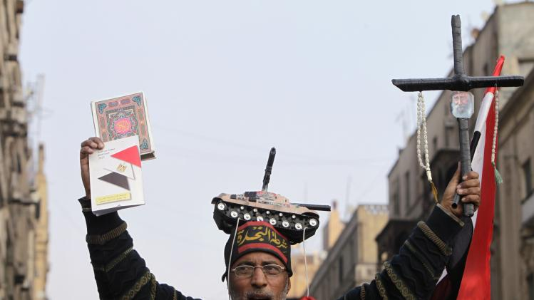 Supporter of Egypt's army chief and defense minister Sisi holds a Koran and a cross during a protest in Cairo
