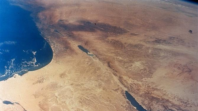 FILE - This undated file photo released by NASA, taken from 175 miles up by Gemini II, shows the Sinai Peninsula, center, in Egypt. Suspected militants in Egypt's Sinai abducted six security personnel as they headed to Cairo for holidays early Thursday, May 16, 2013, security officials said, the first such kidnapping of security forces in the increasingly lawless peninsula.(AP Photo/NASA, File)