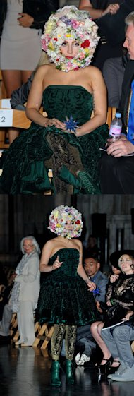Lady Gaga is appropriately flamboyant in a giant floral headpiece on the FROW at Philip Treacy SS13