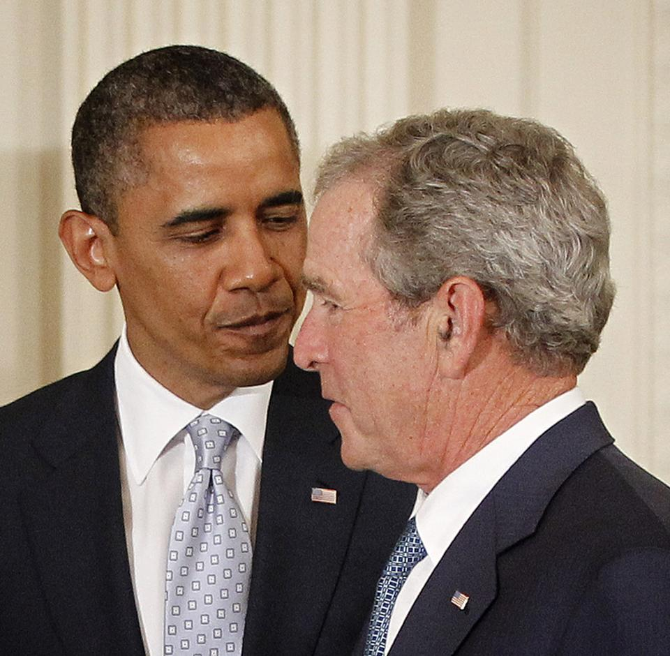 President Barack Obama talks with former President George W. Bush in the East Room of the White House in Washington, Thursday, May 31, 2012, during a ceremony to unveil the Bush portraits. (AP Photo/Pablo Martinez Monsivais)