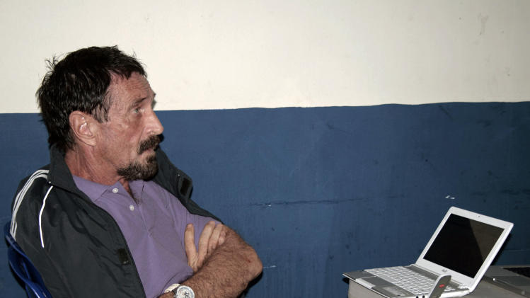 In this photo released by Guatemala's Human Rights Ombudsman's office, software company founder John McAfee is pictured in an immigration detention center in Guatemala City, Thursday, Dec. 6, 2012. The anti-virus guru was arrested at a hotel in an upscale neighborhood with the help of Interpol agents, hours after he said he would seek asylum in the Central American country. Guatemalan authorities were awaiting orders from their Foreign Ministry about whether to send him back to Belize, where he is a person of interest in the killing of a fellow expatriate American. (AP Photo/Guatemala's Human Rights Ombudsman's office)