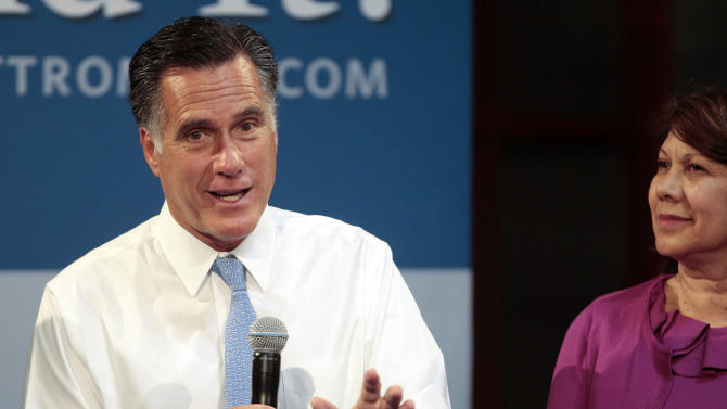 Republican presidential candidate, former Massachusetts Gov. Mitt Romney, accompanied by Beverly Oncology and Imaging CEO Ruth Lopez Novodor hosts a small-business roundtable during a campaign stop at Endural LLC, Monday, July 23, 2012, in Costa Mesa, Calif. (AP Photo/Jason Redmond)