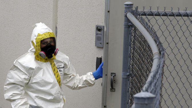 A Prince George's County, Md. firefighter dressed in a protective suit walks into a government mail screening facility in Hyattsville, Md., Wednesday, April 17, 2013. Police swept across the U.S. Capitol complex to chase a flurry of reports of suspicious packages and envelopes Wednesday after preliminary tests indicated poisonous ricin in two letters sent to President Barack Obama and a Mississippi senator.  (AP Photo/Alex Brandon)