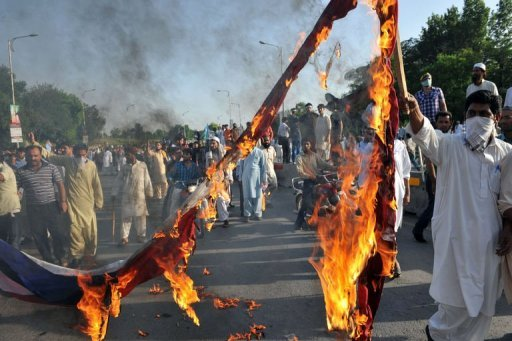 <p>Pakistani Muslim demonstrators burn a US flag as they attempt to reach the US embassy during a protest against an anti-Islam film in Islamabad. Frustrated the US government's message denouncing an anti-Islam film is failing to be heard, the State Department is turning to social media and television ads to try to stem global protests.</p>
