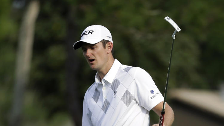 Justin Rose, of England, reacts after missing a birdie putt on the 17th green during the third round of the Arnold Palmer Invitational golf tournament, Saturday, March 23, 2013, in Orlando, Fla. (AP Photo/John Raoux)