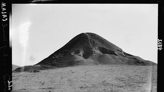 "This undated handout photo provided by the Library of Congress taken during the autumn of 1932 shows a hill at the site of the ancient city of Nimrud, the second capital of Assyria, an ancient kingdom that began in about 900 B.C., south of Mosul, northern Iraq. Islamic State militants ""bulldozed"" the renowned archaeological site of the ancient city of Nimrud in northern Iraq on Thursday, March 5, 2015 using heavy military vehicles, a statement from Iraq's Ministry of Tourism and Antiquities said. The city, which was destroyed in 612 B.C., is located on the Tigris River just south of Iraq's second largest city, Mosul, which was captured by the Islamic State group in June.(AP Photo/American Colony Photo Department via Library of Congress)"