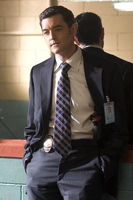 "Timothy Omundson as Detective Lassiter in ""Psych."""