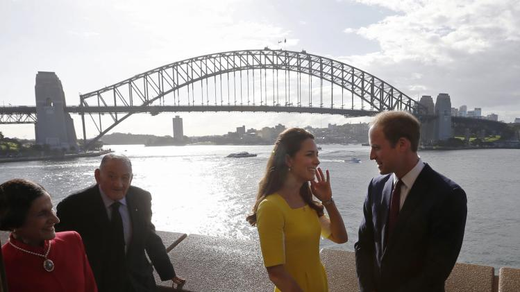 Britain's Prince William and his wife Catherine, the Duchess of Cambridge, are pictured in front of the Sydney Harbour Bridge during a reception at the Sydney Opera House