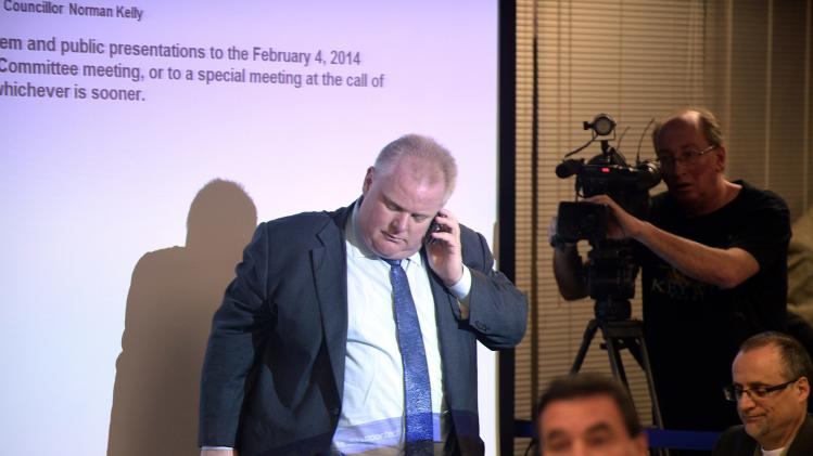 Toronto Mayor Rob Ford talks on the phone during an executive committee meeting in Toronto