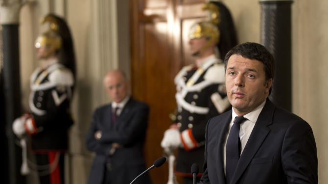 Italian Democratic Party's leader Matteo Renzi talks to journalists at the Quirinale presidential palace after talks with Italan President Giorgio Napolitano, in Rome, Monday, Feb. 17, 2014. Renzi was asked to form a new government to replace the one he sacked through a stunning power-grab within his own party. Renzi drove himself to his meeting with Napolitano, mimicking the down-to-earth approach of his predecessor, Enrico Letta.(AP Photo/Alessandra Tarantino)