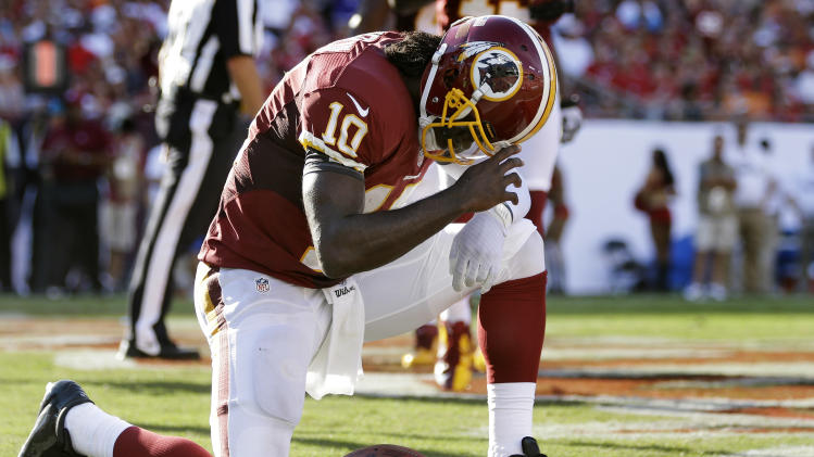 Washington Redskins quarterback Robert Griffin III (10) reacts after scoring on a five-yard touchdown run against the Tampa Bay Buccaneers during the second quarter of an NFL football game Sunday, Sept. 30, 2012, in Tampa, Fla. (AP Photo/Margaret Bowles)