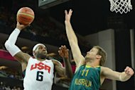 US forward LeBron James scores past Australian forward Mark Worthington during their London 2012 Olympic Games men's quarterfinal basketball match in London on August 8, 2012. AFP PHOTO /MARK RALSTON