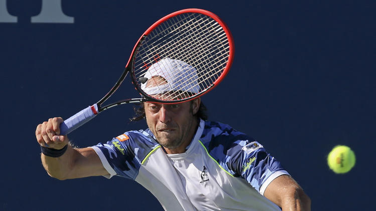 Paolo Lorenzi, of Italy, returns a shot to Richard Gasquet, of France, during the second round of the 2014 U.S. Open tennis tournament, Friday, Aug. 29, 2014, in New York. (AP Photo/John Minchillo)