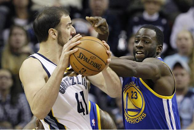 Golden State Warriors' Draymond Green (23) pressures Memphis Grizzlies' Kosta Koufos (41) in the first half of an NBA basketball game in Memphis, Tenn., Saturday, Nov. 9, 2013
