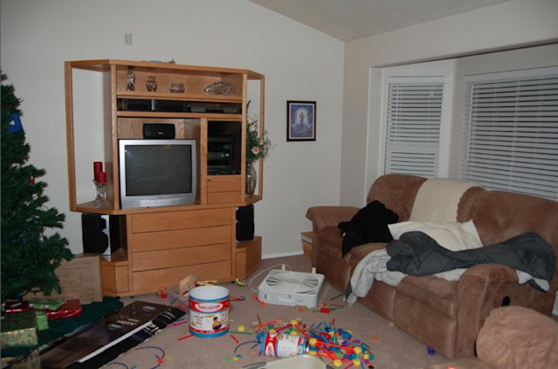 This undated evidence photo released Monday, May 20, 2013, by the West Valley City Police Department shows the living room of Josh and Susan Powell's house. Citing a lack of leads, a police agency sai