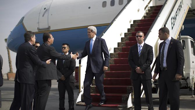 U.S. Secretary of State John Kerry arrives in Cairo, Sunday, Nov. 3, 2013. Kerry is in Cairo pressing for reforms during the highest-level American visit to Egypt since the ouster of the country's first democratically elected president. The Egyptian military's removal of Mohammed Morsi in July led the U.S. to suspend hundreds of millions of dollars in aid. This is the first stop in an 11-day trip that will take Kerry to the Mideast and Europe. (AP Photo/Jason Reed, Pool)