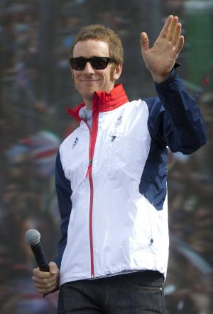 "FILE - In this Saturday, Aug. 4, 2012 file photo, British cyclist Bradley Wiggins greets fans on stage for BT London Live concert at Hyde Park in central London. Tour de France champion Bradley Wiggins was recovering in hospital Wednesday, Nov. 7, 2012, after being hit by a car while riding his bike in northern England. Team Sky said Wiggins will be kept in the hospital overnight for observation, but that ""the injuries he sustained are not thought to be serious and he is expected to make a full and speedy recovery."" (AP Photo/Joel Ryan, File)"