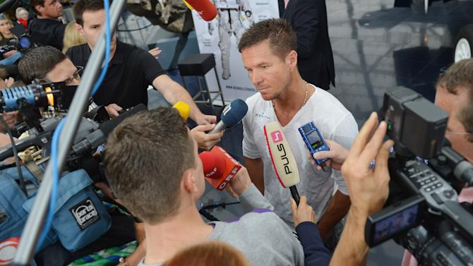 Austria's Felix Baumgartner  speaks to journalists after a press conference  in Salzburg, Austria  on Saturday Oct. 27, 2012 . Supersonic skydiver Felix Baumgartner has finally come home after his death-defying, record-breaking leap from the edge of space.  The Austrian former military parachutist faced reporters in his home city of Salzburg on Saturday, nearly two weeks after his plunge from a balloon to the New Mexico desert made him the first person to reach supersonic speed without traveling in a jet or spacecraft. (AP Photo/Kerstin Joensson)